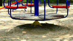 Empty childrens swings in the park in motion. Camera to top. Stock Footage