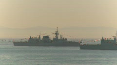 Military, navy, Seaking helicopters pass frigates Stock Footage