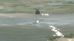 National Guard drops sand bags to protect islands from Gulf BP oil spill_01 Stock Footage