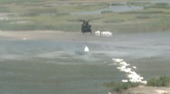 Stock Video Footage of National Guard drops sand bags to protect islands from Gulf BP oil spill_01