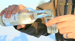 Pouring vodka outdoors in the winter Stock Footage