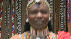 A smiling Masai man with beads and full costume. Stock Footage