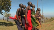 Stock Video Footage of Masai warriors perform a ritual dance in Kenya, Africa.