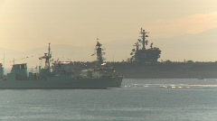 Military, HMCS Algonquin passes Aircraft carrier Stock Footage