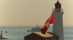 Flag, huge Canada flag on Fisgard lighthouse Stock Footage