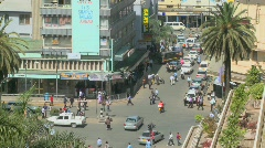 Pedestrians walk on busy streets in Nairobi, Kenya. Stock Footage
