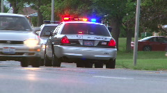 Two Police Cars sitting in the Middle lane Stock Footage