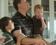 Father overwhelmed with children Stock Footage