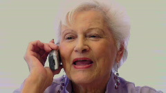 Older Woman Talks On Her Cell Phone - stock footage