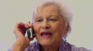 Older Woman Talks On Her Cell Phone Stock Footage