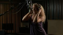 Woman in a recording studio Stock Footage