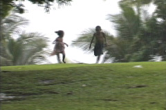 Fiji children running in the rain Stock Footage