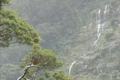Rain falling on mountain side Stock Footage
