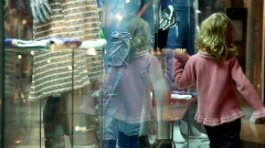 Little girl walking along the museum display window Stock Footage