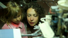 mother telling little girl about space exhibit - stock footage