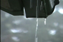 Rain dripping from gutter Stock Footage
