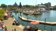 People on the inner harbor (pt2), Victoria BC time lapse, summer day Stock Footage