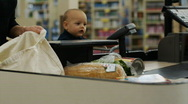 Stock Video Footage of mother and baby at grocery store check-out