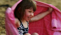 Little girl at the beach in a towel Stock Footage