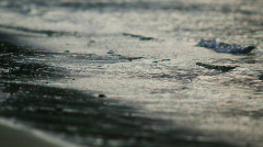 Waves lapping on the sand Stock Footage