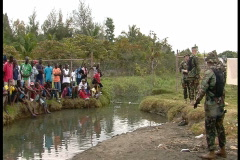 Haitian Crowd Watches Soldiers (HD) co Stock Footage