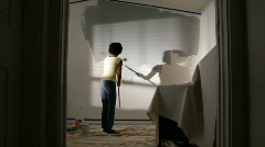 Couple painting a bedroom Stock Footage