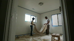 Couple painting a room Stock Footage