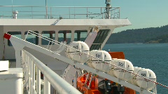 Maritime transportation, life raft barrels on ferry Stock Footage