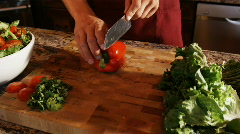 Hands chopping a red pepper Stock Footage