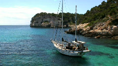 Sailing Boat in a Mediterranean Bay Stock Footage