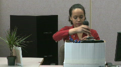Businesswoman cleaning out her desk Stock Footage