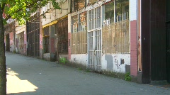 Man walks by barred stores eastend, poverty & economy Stock Footage
