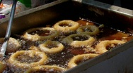 Cook deep frying onion rings at the county fair Stock Footage