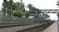Passenger Train Departs Station Stock Footage