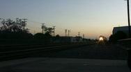 Stock Video Footage of Amtrak Passenger Train Arrives at Sunset