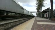 Stock Video Footage of Intermodal Freight Train Passes Thru Station