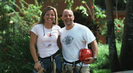 Stock Video Footage of couple wearing harnesses about to go on a zip line tour through the Costa Rican