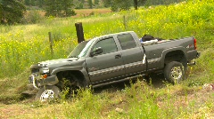 Auto accident, tow truck pulling wrecked pick up truck Stock Footage