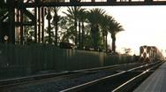 Stock Video Footage of Container Train Passes Under Bridge