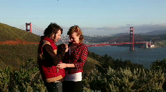 Young couple taking a self-portrait at the Golden Gate Bridge Stock Footage