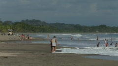 People enjoying themselves at a Costa Rican beach Stock Footage