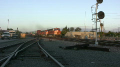 Freight Train Passing Thru Station - stock footage