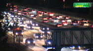 Stock Video Footage of nighttime rush hour on 8 lanes of highway