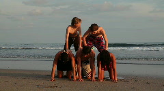 Family making a human pyramid at the beach Stock Footage