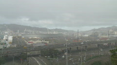 Rain squall over railyards timelapse Stock Footage