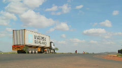A Maersk Sealand truck sits beside a highway in rural Kenya. Stock Footage