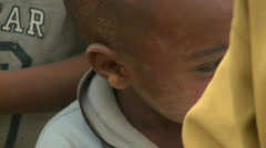 A cute face of a young boy in Africa. - stock footage