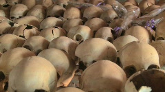Pan across hundreds of skulls crushed during the genocide in Rwanda. - stock footage