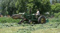 Tractor farm cutting alfalfa side P HD 1051 Stock Footage