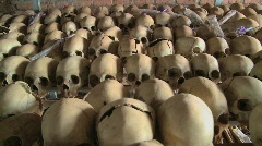Dolly along hundreds of skulls in rows in a church following the genocide in - stock footage